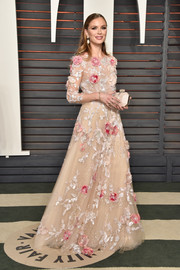 Georgina Chapman enchanted at the Vanity Fair Oscar party in a princess-worthy flower-appliqued nude gown.