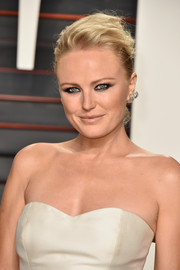 Malin Akerman was grunge-chic at the Vanity Fair Oscar party with this messy updo teamed with a smoky eye.