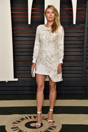 Maria Sharapova looked very fashion-forward at the Vanity Fair Oscar party in this white Preen number, boasting intricate floral beading, laced seams, and an asymmetrical hem.