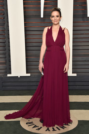 Tina Fey donned a wine-colored Grecian gown by Carolina Hererra for the Vanity Fair Oscar party.