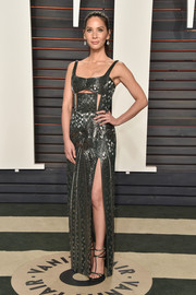 Olivia Munn was edgy, sexy, and glam all at once in this metallic cutout gown by J. Mendel at the Vanity Fair Oscar party.