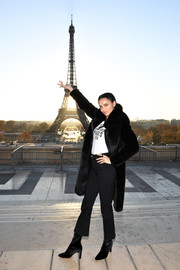 Adriana Lima bundled up in luxurious style with a black fur coat for the Victoria's Secret photo op at the Eiffel Tower.