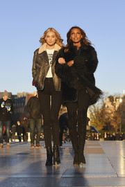 Jasmine Tookes looked posh in a black fur coat while headed to the Eiffel Tower for the Victoria's Secret photo op.