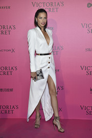 Adriana Lima polished off her look with a pair of two-tone ankle-cuff sandals.