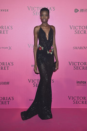 Maria Borges oozed sultry glamour wearing this plunging black sequin gown by Michael Costello at the Victoria's Secret fashion show after-party.