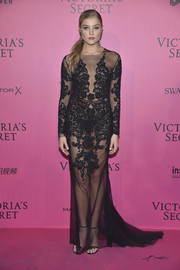 Rachel Hilbert paired her dress with black skinny-strap sandals.