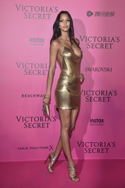 Lais Ribeiro looked jaw-droppingly sexy in a gold cowl-neck halter dress at the Victoria's Secret fashion show after-party.