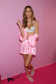 Josephine Skriver lounged backstage at the Victoria's Secret fashion show wearing a pink robe over white underwear.
