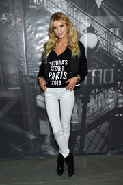 Maggie Laine layered a black track jacket over her VS tee for the 2016 Victoria's Secret fashion show photo op.