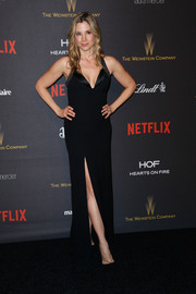 Mira Sorvino flaunted her ageless figure in a form-fitting black halter gown with a thigh-high slit at the Weinstein Company and Netflix Golden Globes after-party.