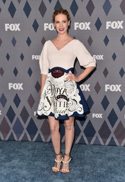 January Jones completed her eye-catching outfit with a pair of pearl-embellished T-strap sandals by Paula Cademartori.