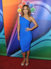 Jennifer Lopez showcased her shapely figure in an electric-blue one-shoulder dress by Victoria Beckham at the NBCUniversal Press Tour.