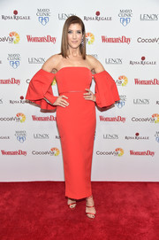 Kate Walsh completed her red ensemble with a pair of strappy satin heels by Sophia Webster.