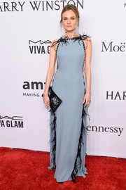 Diane Kruger's gemstone clutch and embellished gown were a very elegant pairing!