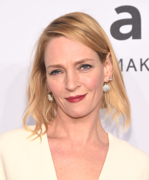 Uma Thurman attended the amfAR New York Gala sporting a simple short hairstyle.