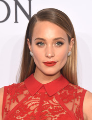 Hannah Davis swiped on some bold red lipstick to match her outfit.