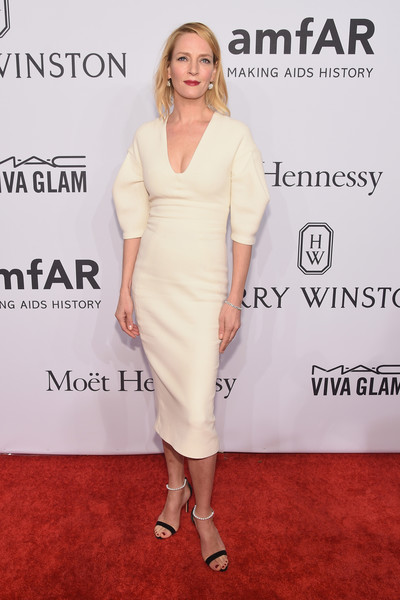 Black-and-white sandals with pearl ankle straps completed Uma Thurman's red carpet attire.
