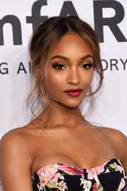 Jourdan Dunn finished off her beauty look with a swipe of red lipstick.