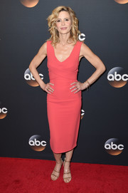 Kyra Sedgwick styled her look with a pair of tan triple-strap sandals.