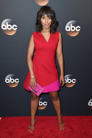 Kerry Washington completed her colorful ensemble with a hot-pink suede clutch.