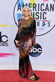 Ashlee Simpson went ultra glam in an ombre sequin gown by Christian Siriano at the 2017 American Music Awards.