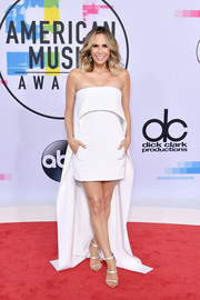 Keltie Knight styled her frock with silver triple-strap sandals.