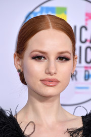 Madelaine Petsch styled her hair into a classic center-parted chignon for the 2017 American Music Awards.