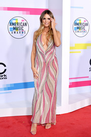 Heidi Klum was a knockout in a vintage Gianni Versace swirl-patterned halter gown at the 2017 American Music Awards.