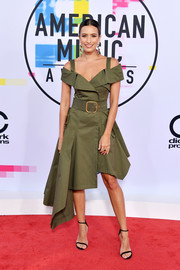 Renee Bargh was cool and edgy in an olive-green trench wrap dress by Monse for FWRD at the 2017 American Music Awards.