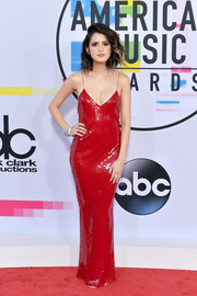 Laura Marano brought plenty of allure to the 2017 American Music Awards with this red sequin slip dress by Stella McCartney.