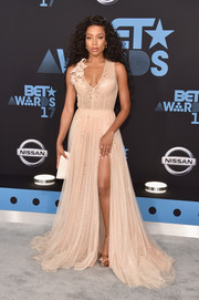 Lil Mama hit the 2017 BET Awards wearing a low-cut nude ball gown by Steven Khalil.