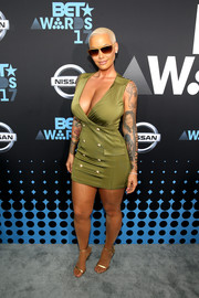 Amber Rose displayed an eyeful of curves in a fitted olive-green mini dress with a plunging neckline at the 2017 BET Awards.