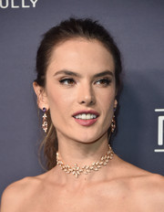 Alessandra Ambrosio added an extra dose of glamour with a pair of dangling gemstone earrings by Narcisa Pheres.