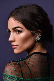Olivia Culpo styled her hair into a messy-glam bun for the 2017 Baby2Baby Gala.