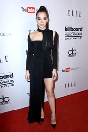 Hailee Steinfeld was modern and edgy in an asymmetrical black cutout dress by Balmain at the Women in Music event.