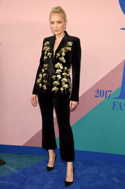 Pom Klementieff went business-glam in an embellished black velvet pantsuit by Altuzarra at the 2017 CFDA Fashion Awards.