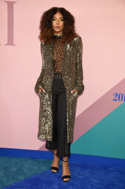 Gabrielle Union arrived for the 2017 CFDA Fashion Awards looking like a rock star in a sequined coat by Rodarte.
