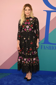Ashley Benson finished off her dress with black ankle-strap pumps.