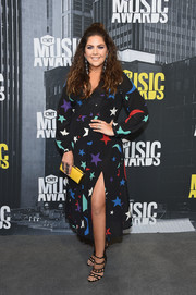 Hillary Scott attended the 2017 CMT Music Awards wearing a colorful moon-and-star-print midi dress.