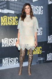 Gold thigh-high lace-up boots finished off the look with a bang!
