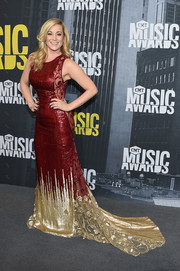 Kellie Pickler got glam in a red and gold sequin gown by Georges Chakra for the 2017 CMT Music Awards.
