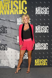 Savannah Chrisley opted for a bright pink short suit when she attended the 2017 CMT Music Awards.
