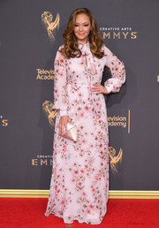 Leah Remini kept it modest and sweet in a long-sleeve floral gown by Giambattista Valli at the 2017 Creative Arts Emmy Awards.