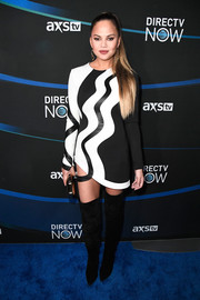 Chrissy Teigen worked a body-con black-and-white mini dress by Alon Livne at the 2017 DIRECTV NOW Super Saturday Night concert.