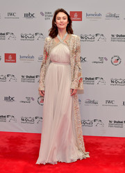 Olga Kurylenko looked breathtaking in a flowing white halter dress by Elie Saab at the 2017 Dubai International Film Festival screening of 'The Death of Stalin.'