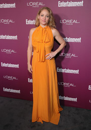 Erika Christensen brightened up the gray carpet with this mustard halter maxi dress at the Entertainment Weekly pre-Emmy party.