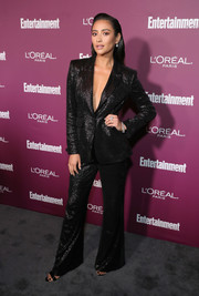 Shay Mitchell brought a '70s vibe to the Entertainment Weekly pre-Emmy party with this shimmery bell-bottom pantsuit by Rachel Zoe.