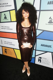 Kiersey Clemons completed her outfit with a nude box clutch and matching pumps.