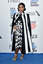 For her shoes, Janelle Monae chose a pair of pearl-adorned ankle-cuff sandals by Christian Louboutin.