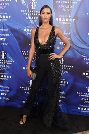 Lais Ribeiro turned plenty of heads in a plunging, paillette-studded high-low top by Thai Nguyen Atelier at the 2017 Fragrance Foundation Awards.